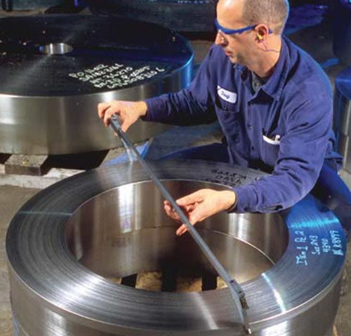 Man measuring steel roll